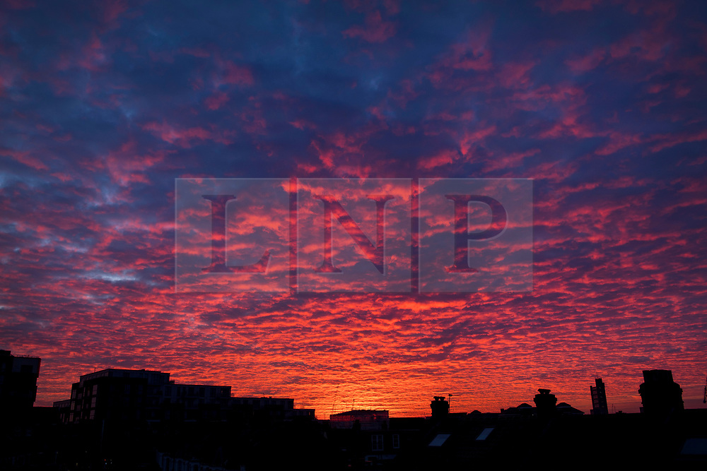 © Licensed to London News Pictures. 12/02/2021. London, UK. A deep red and orange sunrise over the city of London, on another morning of sub zero temperatures in the capital. Photo credit: Ben Cawthra/LNP