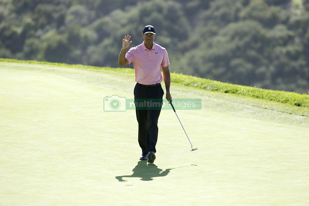 January 27, 2019 - San Diego, CA, USA - Tiger Woods makes a birdie putt on the 3rd hole during the fourth round of the Farmers Insurance Open at the Torrey Pines Golf Course in San Diego on Sunday, Jan. 27, 2019. (Credit Image: © K.C. Alfred/San Diego Union-Tribune/TNS via ZUMA Wire)