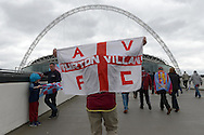 Aston Villa fans holds up a Aston Villa flag outside Wembley Stadium before k/o. The FA Cup, semi final match, Aston Villa v Liverpool at Wembley Stadium in London on Sunday 19th April 2015.<br /> pic by John Patrick Fletcher, Andrew Orchard sports photography.