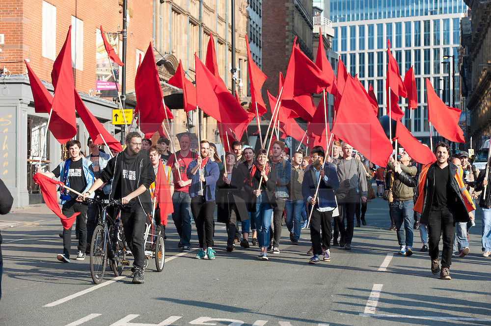 © Licensed to London News Pictures. 04/10/2015.Solidarity put on a good show for the march. An estimated 85 thousand take part in a National Demonstration march through the city. A week of pro-peace, anti-austerity, anti-war, anti-Tory, protests dubbed 'Take Back Manchester' has been  organised by The People's Assembly and timed to coincide with the Conservative Party Conference in Manchester on 4th - 7th Oct 2015. Over 40 events are planned, including a speech by new Labour leader Jeremy Corbyn timed to compete with closing speech of Tory leader David Cameron. Photo credit: Graham M. Lawrence/LNP