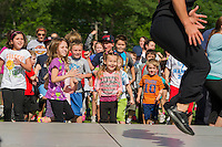 """Trish Tryon from Laconia Athletic and Swim Club gets these youngsters off their feet during """"Workout Laconia"""" Thursday morning at Opechee Park.   (Karen Bobotas/for the Laconia Daily Sun)"""
