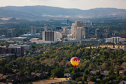 """""""Balloon Over Reno 5"""" - This hot air balloon was photographed flying over Reno, Nevada during the 2011 Great Reno Balloon Race. Photographed from a hot air balloon."""