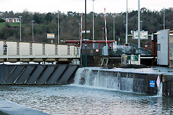 © Licensed to London News Pictures. 01/02/2014; Bristol, UK. Spring tide flooding from the river Avon overtops the walls of Bristol docks at the Cumberland Basin and flows into Bristol's Floating Harbour. Nearby a portable flood barrier was set up in Avon Crescent near Bristol docks to protect a row of houses from spring tide flooding from the river Avon.  01 February 2014.<br /> Photo credit: Simon Chapman/LNP