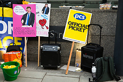 London, UK. 13th February, 2019. Placards prepared by Public & Commercial Services (PCS) union members for a picket line with outsourced worker colleagues who walked out from the Department of Business, Energy and Industrial Strategy (BEIS) for their second day of strike action to demand the London Living Wage and an end to outsourcing. Union members handed out strike-themed cakes to supporters in return for donations to the strike fund.