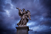 The statue Angel with a Cross, by Ercole Ferrata, Ponte Sant'Angelo, Rome the day before the start of conclave and the picking of the new Pope in Vatican City, March 11, 2013. Photograph by Todd Korol