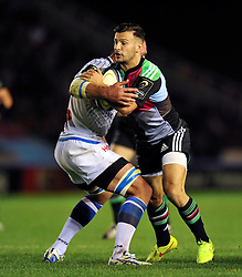 Danny Care of Harlequins takes on the Castres defence - Photo mandatory by-line: Patrick Khachfe/JMP - Mobile: 07966 386802 17/10/2014 - SPORT - RUGBY UNION - London - Twickenham Stoop - Harlequins v Castres Olympique - European Rugby Champions Cup