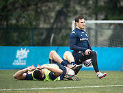 Fly-half BENJAMIN DAMBIELLE of French rugby union team, Racing 92 from Paris, stretching during training in Hong Kong. They are preparing ahead of their upcoming match against New Zealand's Super League team, The Highlanders