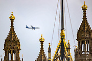 """A civilian aircraft of """"Aegean Airlines"""" is seen flying by the domes of Westminster Palace, Houses of Parliament following torrential rain that downpoured in Britain's capital on Sunday, Aug 8, 2021. Some say that London weather can be one of two things: abjectly miserable or incomparably wonderful. There is no in-between. (VX Photo/ Vudi Xhymshiti)"""