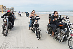 Jim Root from the Band Slipknot (L) with Deneille Basualdo and Kissa Von Addams, riding on Daytona Beach during Daytona Bike Week 75th Anniversary event. FL, USA. Thursday March 3, 2016.  Photography ©2016 Michael Lichter.