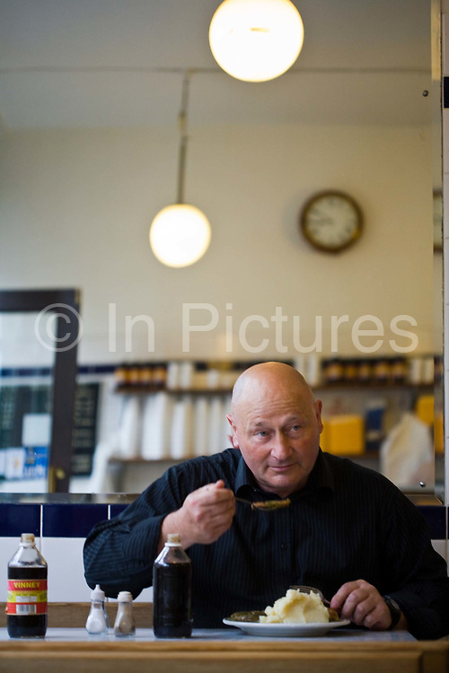 A customer eats a plate of eels, pie and mash in Cookes' Eel, Pie and mash shop in Hoxton, London, UKEel, pie and mash shops are a traditional but dying business. Changing tastes and the scarcity of the eel has meant that the number of shops selling this traditional working class food has declined to just a handful mostly in east London. The shops were originally owned by one or two families with the earliest recorded, Manze's on Tower Bridge Road being the oldest surviving dating from 1908. Generally eels are sold cold and jellied and the meat pie and mash potato covered in a green sauce called liquor.