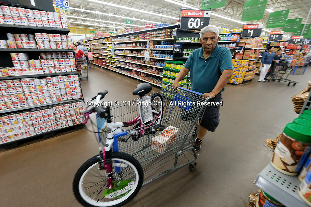 People shop at Walmart in Calexico (the US and Mexico border), California on Wednesday April 19, 2017. (Xinhua/Zhao Hanrong)