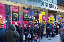 © Licensed to London News Pictures. 05/12/2020. LONDON, UK.  Shoppers queue to enter Debenhams department store in Oxford Street on the first Saturday after lockdown restrictions were lifted on 2 December.  Retailers are hoping that physical sales will pick up in the run up to Christmas.  This comes against a backdrop of two major retailers Debenhams and Arcadia, owner of Topshop, collapsing into administration in the last week.  Photo credit: Stephen Chung/LNP