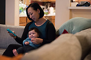 AUSTIN, TEXAS - FEBRUARY 9: Jinny Suh plays with her 4-month-old son at her home in Austin, Texas on February 9, 2017. Jinny is a pro-vaccine advocate in addition to running her own businesses from home and raising her two sons. (Photo by Cooper Neill for The Washington Post)