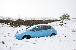 © Licensed to London News Pictures. 09/11/2016. Ilkley UK. Picture shows a Nissan car that has crashed through a fence & landed in a field on Ilkley Moor after heavy snowfall this morning. Photo credit: Andrew McCaren/LNP