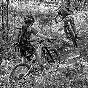 Heather Goodrich being chased by her 9-year-old son Micah on autumn single track in Wyoming.