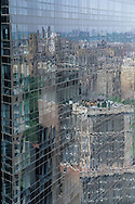 New york mirror tower, elevated view, reflection of Manhattan skyline midtown and central park  on a building