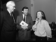"""""""These Obstreperous Lassies"""" Book Launch.  (R93)..1988..15.12.1988..12.15.1988..15th December 1988..A book which chronicles an important aspect of Irish social history was launched in Larkin Hall. """"These Obstreperous Lassies"""" written and researched by Mary Jones, details the seventy three years of the Irish Women Workers Union and of the women who were involved in the union..With Countess Markievicz as its first president, The Union began the fight for equal pay and fair treatment under the leadership of women like helen Chenevix, Louise Bennett and Helena Molloy. They fought for the rights of vulnerable workers such as Laundresses,print workers,box makers,nurses and dressmakers..The Author, Mary Jones, is a full time researcher specialising in Women and Work...Picture shows the Author Mary Jones chatting with John Horgan, Chairman of the Labour Court and (an un-named) a gentleman on the left."""
