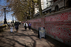© Licensed to London News Pictures. 08/04/2021. London, UK. The National Covid Memorial Wall, which has now been completed with approximately 150,000 hearts painted on the Thames Embankment opposite the Houses of Parliament to remember those who lost their lives to Covid-19. Members of the public are invited to walk the length of the memorial, and campaigners are asking Prime Minister Boris Johnson to make the memorial permanent. Photo credit: Rob Pinney/LNP