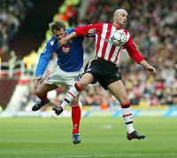 Photograph: Scott Heavey.<br />Southampton v Portsmouth. FA Barclaycard Premiership. 21/12/2003.<br />Chris Marsden beats Teddy Sherringham to the ball