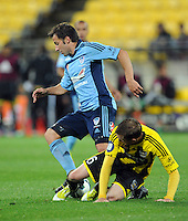 Sydney's Alessandro del Pier, left, is tackled by Wellington Phoenix's Alex Smith in the A-League foootball match at Westpac Stadium, Wellington, New Zealand, Saturday, October 06, 2012. Credit:SNPA / Ross Setford