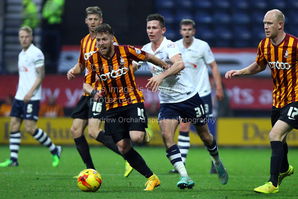 Bradford City's Billy Clarke (l) looks to get away from Preston North End's Alan Browne. Skybet football league one match, Preston North End v Bradford city at Deepdale in Preston, Lancs on Saturday 15th November 2014.<br /> pic by Chris Stading, Andrew Orchard sports photography.
