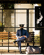 Cadet Joshua McKinley of Victor Company waits at the CARTA Bus Stop outside Lesesne Gate at the end of The Citadel's in-person Fall semester on November 24, 2020.<br /> <br /> Credit: Cameron Pollack / The Citadel