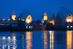 © Licensed to London News Pictures. 08/01/2014. London, UK. The Thames Barrier on the River Thames closed for the thirteenth consecutive tide this evening as part of the London flood defence strategy, 8 January 2014  Photo credit : Vickie Flores/LNP