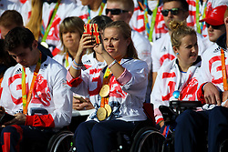 © Licensed to London News Pictures. 18/10/2016. London, UK. Multi-gold medalist wheelchair racer HANNAH COCKROFT takes a picture of the crowd as Olympic and Paralympic athletes, who competed in the Rio 2016 Olympics receive hero's welcome in Trafalgar Square on Tuesday, 10 October 2016. Photo credit: Tolga Akmen/LNP