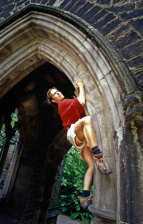 Johnny Dawes climbing an abandoned church in Sheffield, England