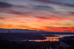 United States, Washington, Bellevue. View of Lake Washington and Seattle, with Olympic Mountains at sunset.