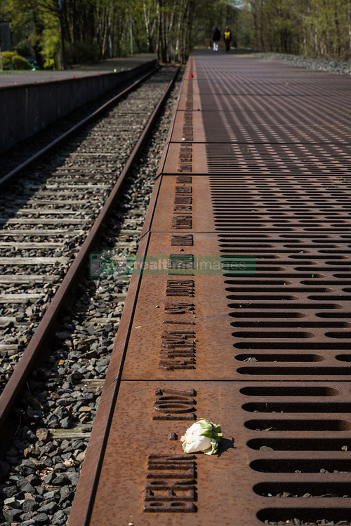 April 18, 2018 - Berlin, Germany - Wednesday, April 18, 2018.A flower rests on a Gleis 17 (Track 17) plaque at the Grunewald Station memorial in Berlin, Germany. Track 17 at the Grunewald Station was one of the major sites of deportation of the Berlin Jews during World War II. ..Prior to 1942, the trains from this site left mainly for the ghettos of Litzmannstadt and Warsaw. But from 1942, the trains went directly to concentration camps including Auschwitz and Thereisienstadt...Plaques with details of every deportation shipment of Jews from Berlin exist on both sides of the platform. More than 50,000 Berlin Jews were sent to ghettos and concentration camps from this station. (Credit Image: © Tracy Barbutes via ZUMA Wire)