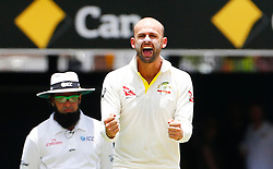 Australia's Nathan Lyon celebrates the wicket of England's Chris Woakes during day two of the Ashes Test match at The Gabba, Brisbane.