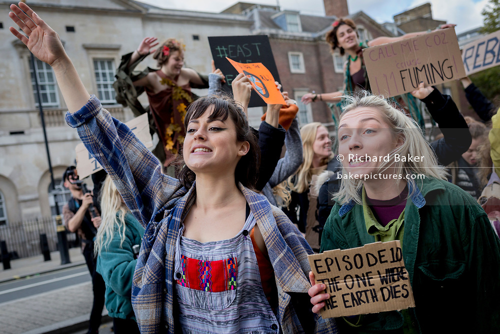 Young women evironmental activists protest about Climate Change during an occupation of Trafalgar Square in central London, the third day of a two-week prolonged worldwide protest by members of Extinction Rebellion, on 9th October 2019, in London, England.