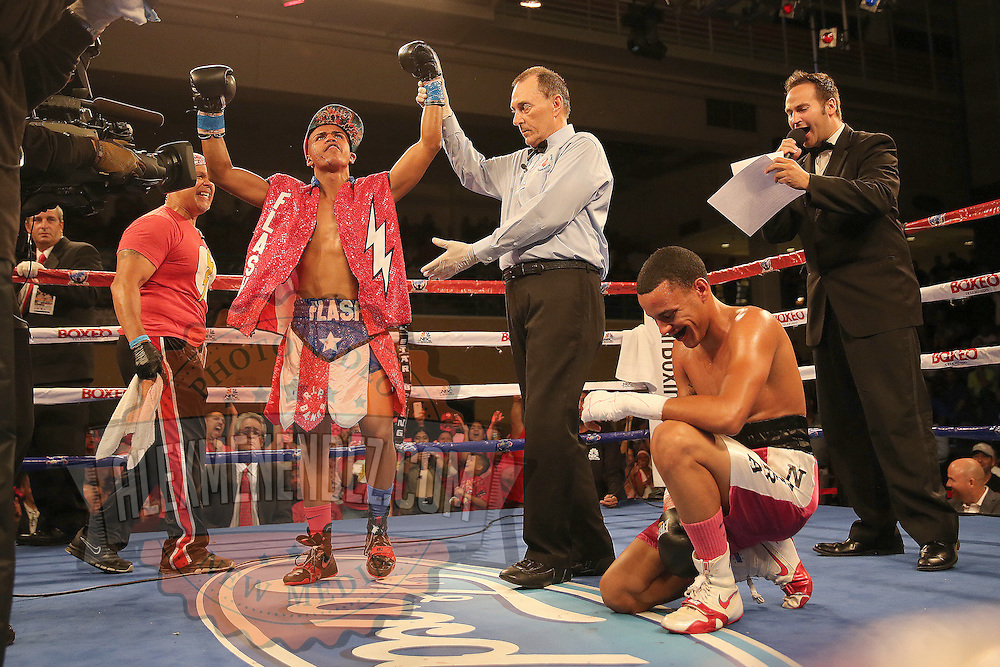 Alex Roman (L) celebrates his victory against Edgardo Marin during a Telemundo boxing match at the Kissimmee Civic Center on Friday, July 17, 2015 in Kissimmee, Florida. Roman won the bout by unanimous decision. (AP Photo/Alex Menendez)