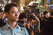 A Hong Kong police officer on duty at the pro-democracy protests in Mong Kok.