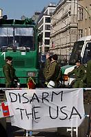 """22 MAR 2003, BERLIN/GERMANY:<br /> Polizei mit Wasserwerfer schuetzt die Botschaft der USA, waehrend einer Anti-Kriegs-Demonstration gegen den Irak-Krieg, an einer Absprerrung haengt ein Transparent """"Disarm the USA"""", Unter den Linden<br /> Police is protecting the US Ebassy during an anti-war demonstration against the iraq war, a banner """"disarm the USA"""" is hanging at a barrier, Unter den Linden<br /> IMAGE: 20030322-01-005<br /> KEYWORDS: peace-demonstration"""