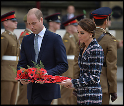 October 14, 2016 - Manchester, England, United Kingdom - Image ¬©Licensed to i-Images Picture Agency. 14/10/2016. Manchester, United Kingdom. The Duke and Duchess of Cambridge visit Manchester. Prince William, The Duke of Cambridge accompanied by his wife Catherine, The Duchess of Cambridge, lay a wreath at the Cenotaph at Manchester Town Hall , As part of a UK Government First World War Centenary campaign, special paving stones are being laid in the hometowns of all those in the United Kingdom who were awarded the Victoria Cross. Picture by Andrew Parsons / i-Images (Credit Image: © Andrew Parsons/i-Images via ZUMA Wire)