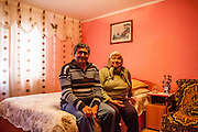Gheorge Gurau (60) with his wife Ana Gurau (58) in their home located in the village of Marginenii de Jos. Mr. Gurau worked his whole professional life as a welder and now his wife and him are pensioners.