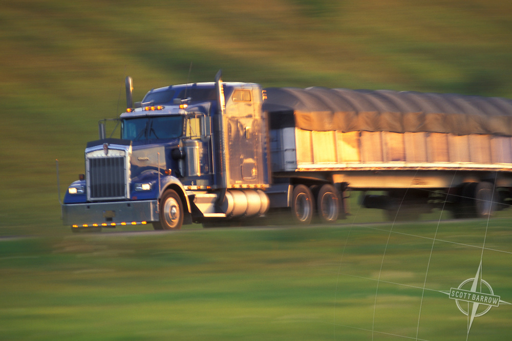oncoming tractor trailer in motion