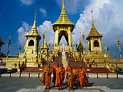 13 DECEMBER 2017 - BANGKOK, THAILAND:  Buddhist monks on the south side of the Royal Crematorium on Sanam Luang in Bangkok. The crematorium was used for the funeral of Bhumibol Adulyadej, the Late King of Thailand. He was cremated on 26 October 2017. The crematorium is open to visitors until 31 December 2017. It will be torn down early in 2018. More than 3 million people have visited the crematorium since it opened to the public after the cremation of the King.    PHOTO BY JACK KURTZ