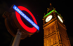 A London Underground sign in front of the Houses of Parliament in Westminster, London, during a 48-hour tube strike as London Underground workers strike over planned job cuts and ticket office closures.