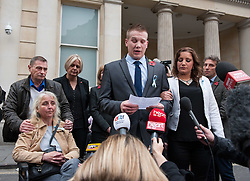 © Licensed to London News Pictures. 11/11/2015. Bristol, UK.  SAM GALSWORTHY the Uncle of murder victim Rebecca Watts, reads a statement at a press call outside Bristol Crown Court watched by DARREN GALSWORTHY and ANJIE GALSWORTHY (left) and Becky's aunt SARAH BROOM (right) after the verdicts were given by the jury in the case of the murder of Rebecca Watts.  Photo credit : Simon Chapman/LNP