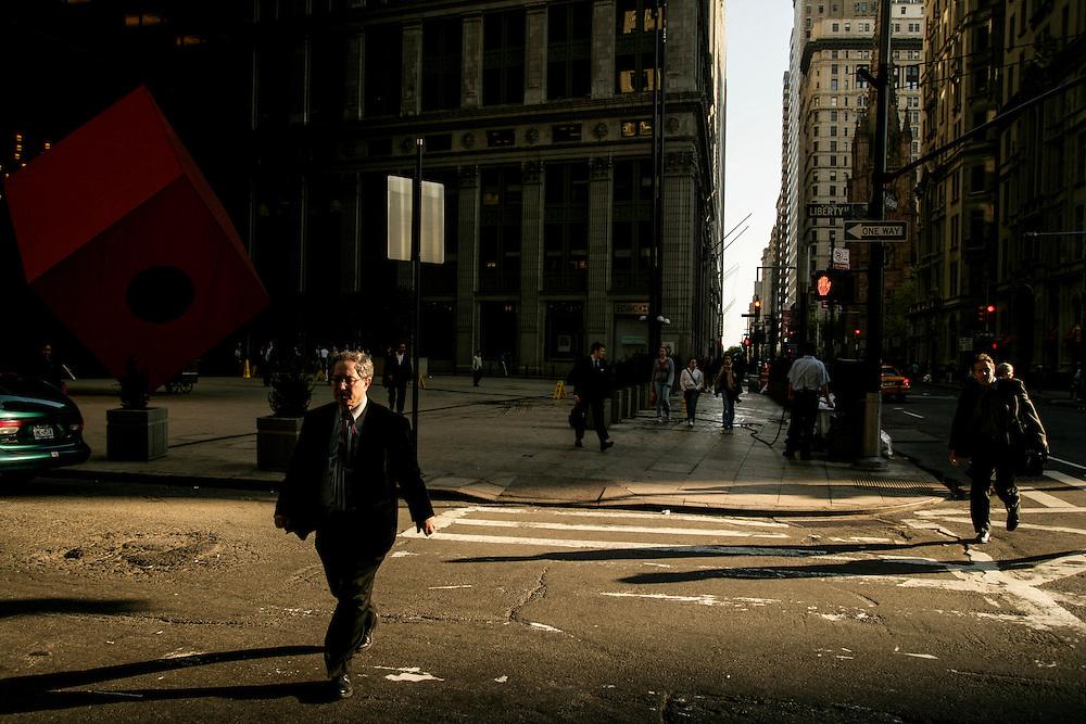 People crossing the street in New York.
