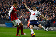 Ben Davies of Tottenham Hotspur (R) in action with Mesut Ozil of Arsenal (L). Premier league match, Tottenham Hotspur v Arsenal at Wembley Stadium in London on Saturday 10th February 2018.<br /> pic by Steffan Bowen, Andrew Orchard sports photography.