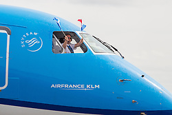 Inverness Airport welcomed KLM's Inaugural flight from Amsterdam. To celebrate the new route, the first flight from Schiphol, Amsterdam was greeted by a water cannon salute upon arrival.  On board were Barry ter Voert, Senior Vice President, Air France KLM European Markets and Wilco Swejen, Director for Aviation Marketing, Schipol Airport.  Provost Helen Carmichael, The Highland Council, Inglis Lyon, Managing Director of Highlands and Islands Aiports and Drew Hendry MP (Inverness, Nairn, Badenoch and Strathspey) met the delegation, officially welcoming the group to the Highlands. <br /> <br /> Pictured: KLM aircraft arrives with flight crew waving flags<br /> <br /> Malcolm McCurrach | EEm | Tue, 17, May, 2016