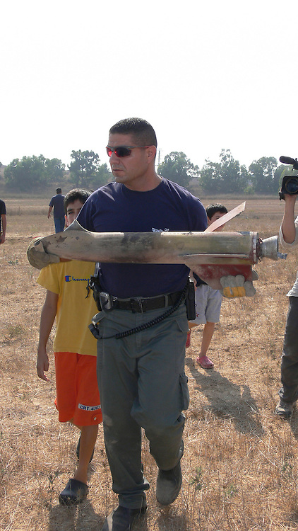 Israel, Sderot, A bomb squad expert removing the remains of a Qassam rocket launched by Hamas from Gaza August 23rd 2007