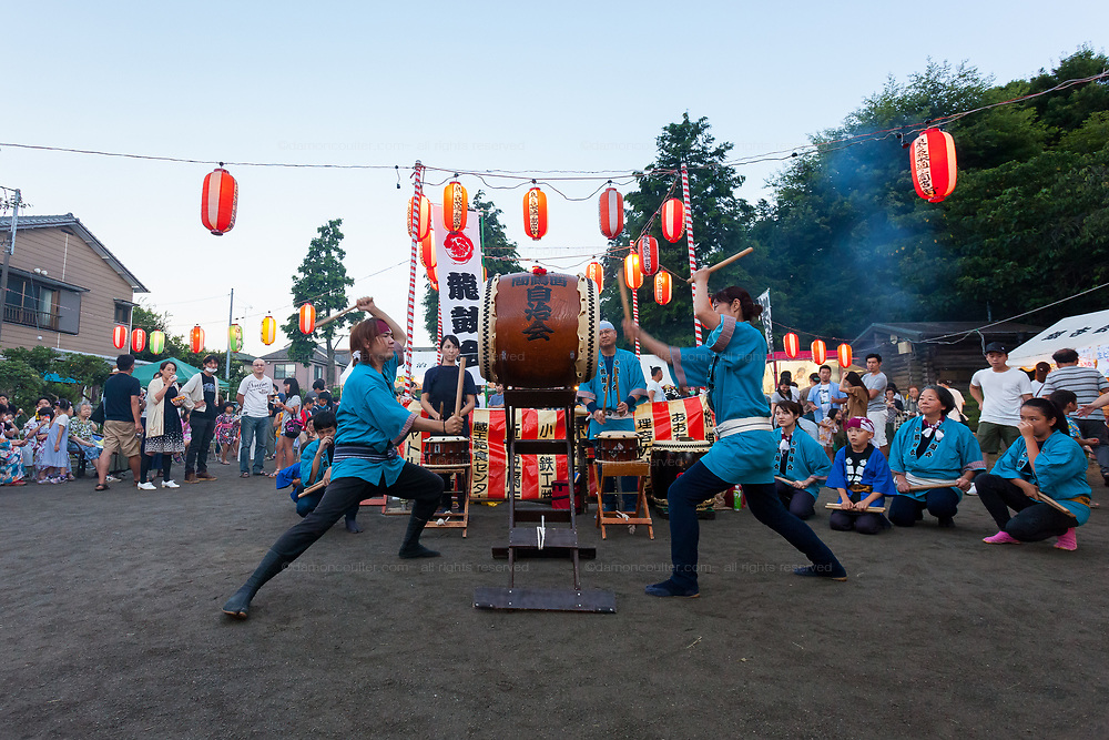 People play Taiko drums at a small local summer festival in a park in Tsuruma, Kanagawa, Japan. Sunday July 29th 2018