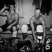 Miners Pete Vaillant and David Butkevich members of the Mine Mill Union Hockey team at a union hockey tournament, Brampton, Ontario. From the book Cage Call: Life and Death in the Hard Rock Mining Belt. An in-depth project spanning over 12-years examining communities in one of the richest mining regions in the world located in Northwestern Ontario and Northeastern Quebec in Canada.