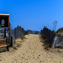 Bethany Beach, DE / USA - April 18, 2015: Dune fences along the walkway to the beach in Bethany, Delaware.