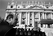 Awaiting the weekly Papal Audience in St Peter's Square, the Vatican. Rome, Italy.